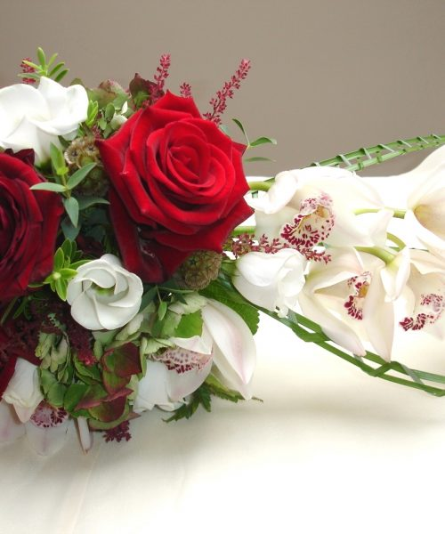 Modern-Trailing-Bouquet-Red-White-Green-Orchid-Rose -Larkspur-Floral-Design