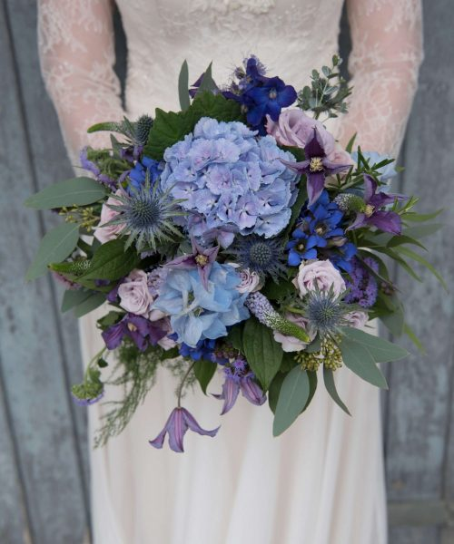 RUSTIC-BRIDAL-with-hydrangea-thistle-rose-clematis