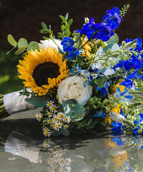 Rustic-sunflower-&-meadow-blooms-bridal-bouquet-Larkspur-Floral-Design-Florist-Cambridge-UK