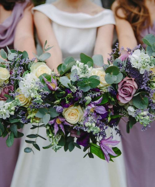 purple lilac bridesmaids bouquets