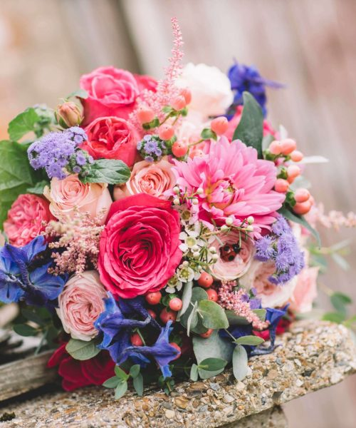 vibrant pink blue bridal bouquet
